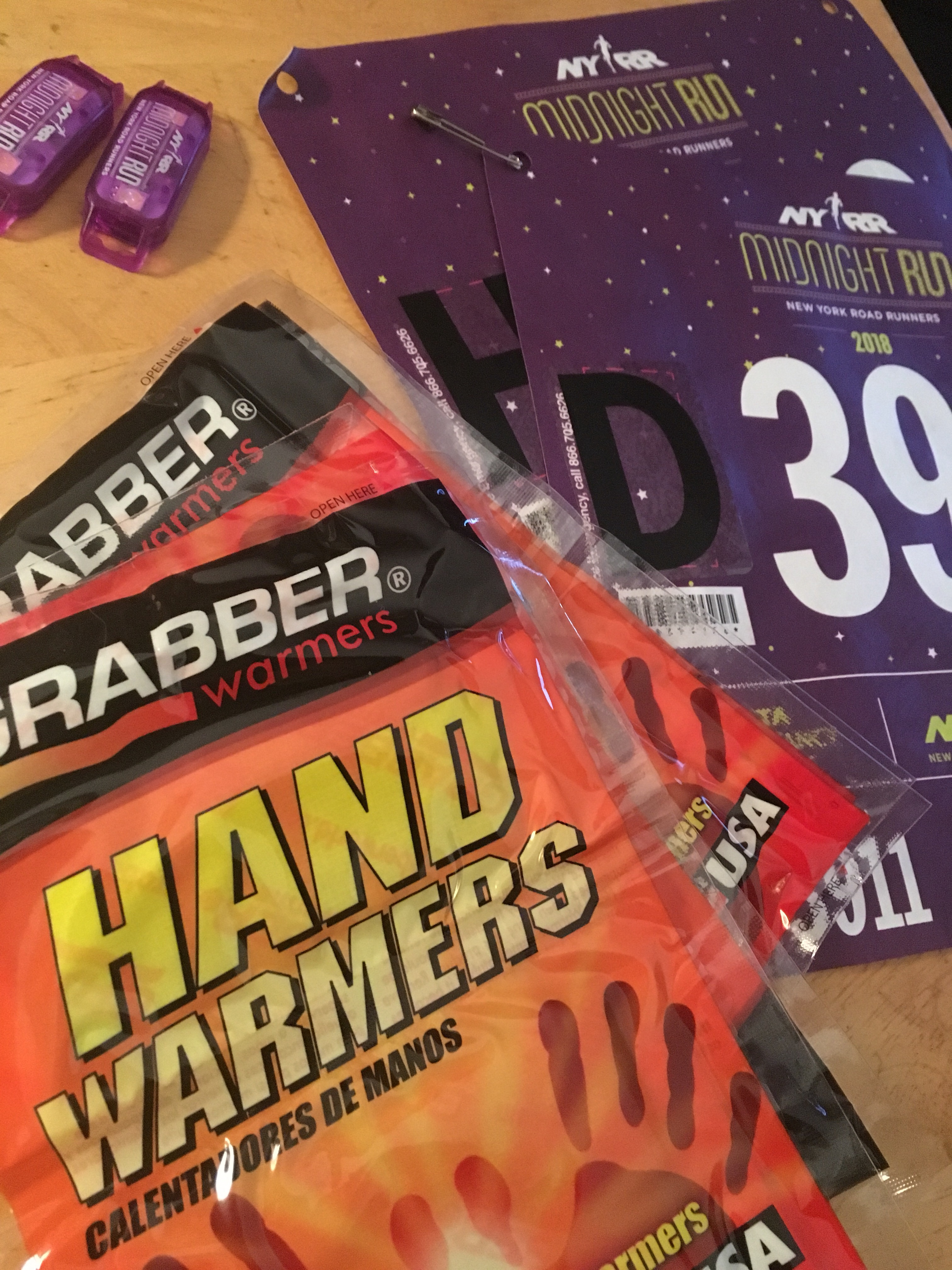 NYRR Midnight Run Bibs, lights, and handwarmers for Central Park cold race